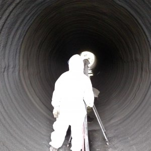 crew spincastin in a metal pipe